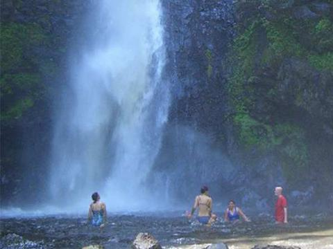 Swimming under the waterfall